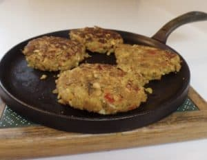 Four Cooked Veggie Patties on a frying pan