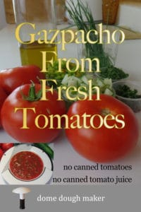 Gazpacho ingredients on a counter, tomatoes, minced cucumbers, minced peppers, olive oil with inset of soup in a bowl